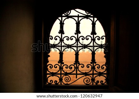 Decorative window in old Marrakesh building Morocco - stock photo