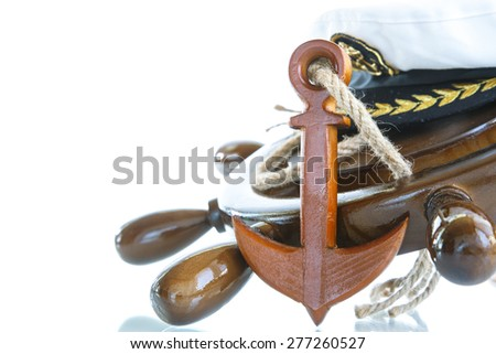 Decorative wooden ship anchored at the helm on a white background - stock photo