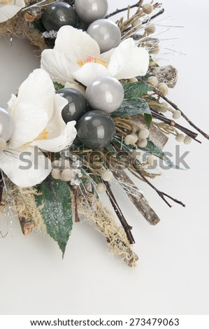 Decorative wreath of dry branches and flowers close up - stock photo