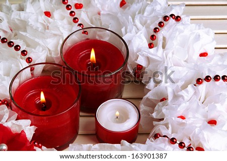 Decorative wreath with candles on wooden background - stock photo