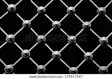 Decorative wrought iron grid, isolated on black - stock photo