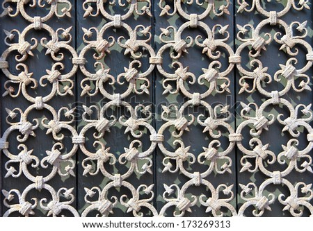 decorative wrought-iron grille on the window - stock photo