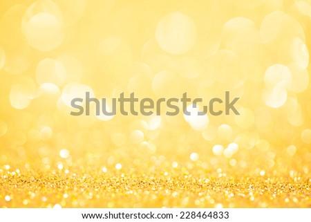 Decorative yellow christmas background with bokeh lights. studio shot - stock photo