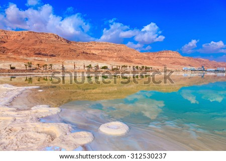 Decrease in water level in the Dead Sea. The evaporated salt acts over a water surface beautiful patterns - stock photo