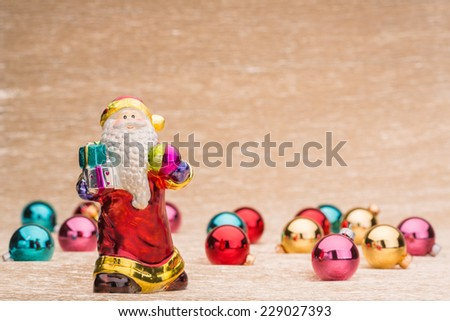 Ded Moroz and christmas balls on illuminated background - stock photo