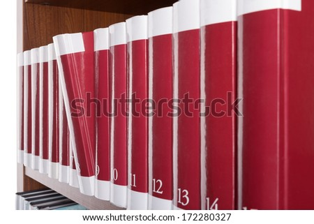Dedicated book is of a bookshelf in the library. Close-up. - stock photo