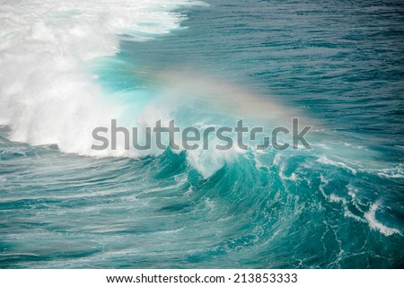 Deep azure and white wave makes rainbow - stock photo