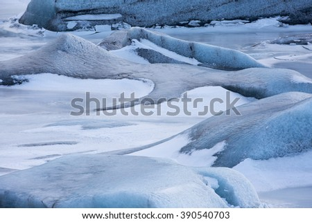 Deep blue colour of Svinafell Glacier and frozen glacial lagoon in Skaftafell National Park, Iceland - stock photo