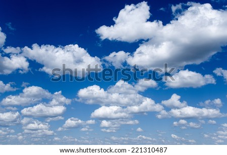 Deep blue sky and clouds. - stock photo