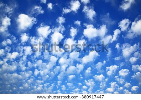 Deep blue sky with clouds, may be used as background - stock photo