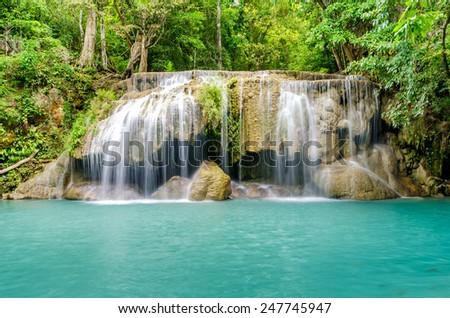 Deep forest waterfall at Erawan waterfall , Kanjanaburi Thailand - stock photo