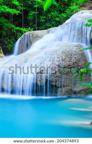 Deep forest waterfall at Erawan waterfall National Park Kanjanab - stock photo