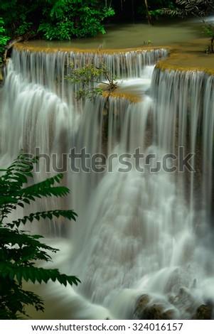 Deep forest waterfall at Huey Mae Khamin waterfall National Park Kanjanaburi Thailand - stock photo