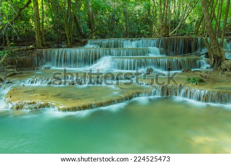 Deep forest waterfall at National Park Kanjanaburi Thailand - stock photo