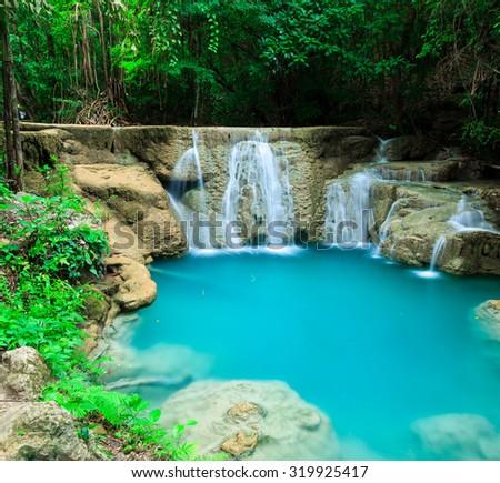 Deep forest waterfall in Huay Mae Kamin Kanjanaburi Thailand - stock photo