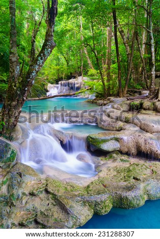 Deep forest Waterfall in Kanchanaburi province, Thailand - stock photo