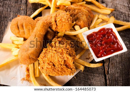 Deep fried chicken legs on the table,from above  - stock photo