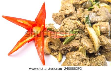Deep fried chicken liver with carved red chili and curry powder - stock photo