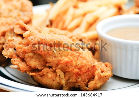 deep fried chicken with french fries and gravy - stock photo