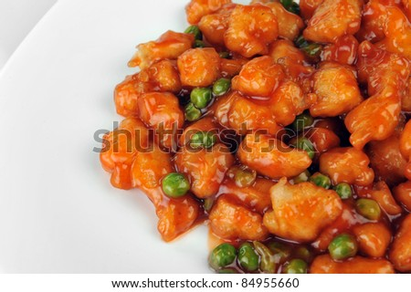 deep fried chicken with red sauce. chinese cuisine - stock photo
