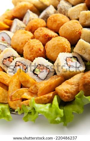 Deep Fried Food with Fresh Salad Leaf - stock photo