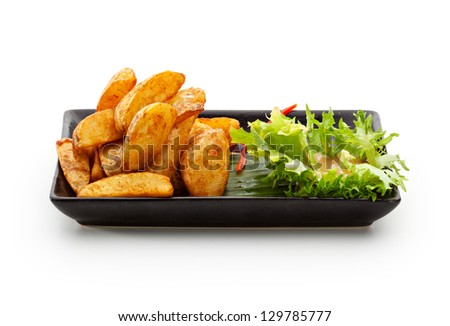Deep Fried Potato Garnished on Salad Leaf with Parsley and Bell Pepper - stock photo