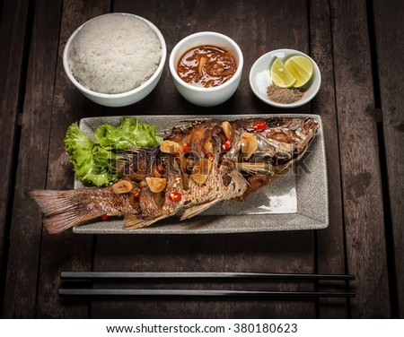 Deep fried red snapper fish served with rice - stock photo