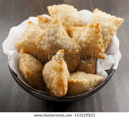 Deep fried stuffed pastry.  - stock photo