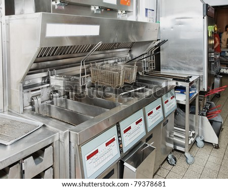 Deep fryer on commercial kitchen - stock photo