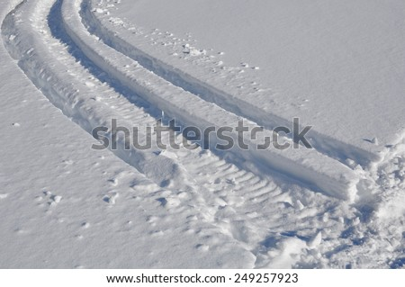 Deep markings of snowmobile - stock photo