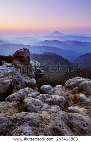 Deep misty spring valley few minutes before the sunrise in national park Bohemian Switzerland - stock photo