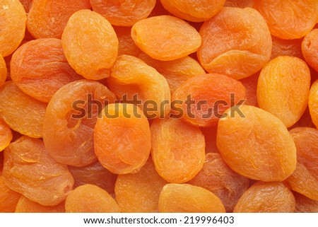 Deep orange dried apricots as an abstract background texture - stock photo