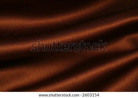 Deep, rich, chocolate coloured satin. Folded and flowing background - stock photo