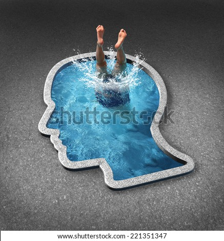 Deep thinking and soul searching concept with a person diving into a swimming pool shaped as a human face as a symbol of self examination and mental health related to inner feelings and emotions. - stock photo