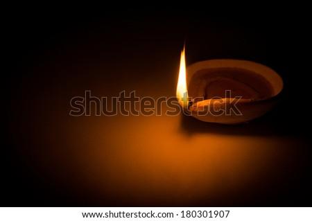 Deepavali Oil Lamp / Oil Lamp / Festive Oil Lamp / Burning the midnight oil - stock photo