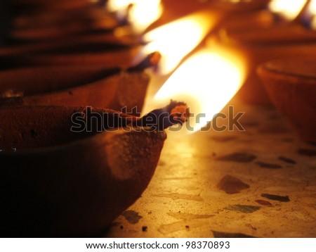 deepavali oil lamps enlighten - stock photo