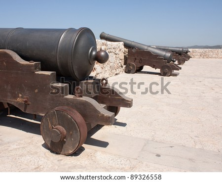 Defense canons in Ibiza old town - stock photo