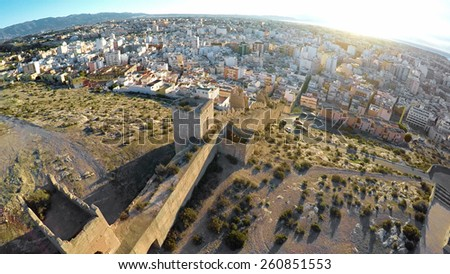 Defense Walls of Ancient fortress Alcazaba of Almeria, Spain - aerial shot including panoramic view of the Almeria city - stock photo