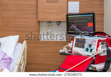 Defibrillator in ICU room at hospital with medical equipments. - stock photo