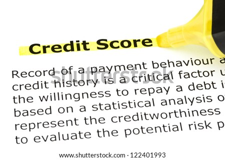 Definition of Credit Score highlighted in yellow with felt tip pen - stock photo