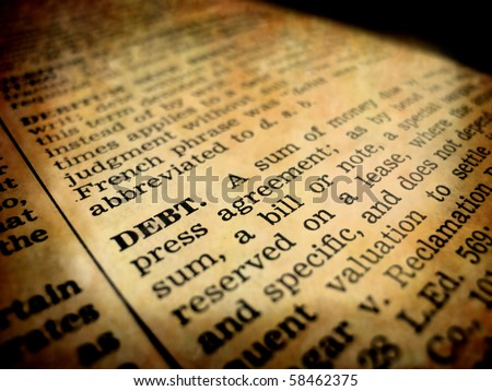 Definition of debt in dictionary book on pages with type - stock photo