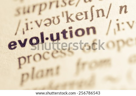 Definition of word evolution in dictionary - stock photo