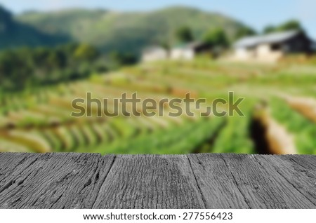 Defocus and blur image of old wood and Beautiful landscape and fresh strawberries farm at Chiangmai ,Thailand for background usage - stock photo