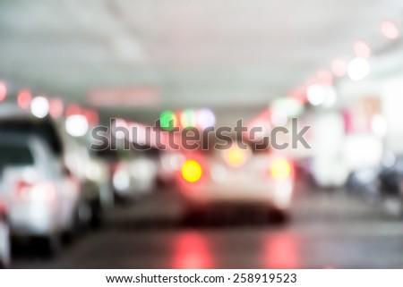 Defocus blur background of indoor car park. - stock photo