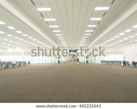 Defocus blurred picture of airport gate for travelers, passengers waiting for their flight at airport - stock photo