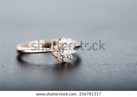 Defocus view. Beautiful ring with diamonds on grey background. Macro view - stock photo