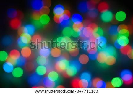 Defocused abstract bokeh light background green, orange, blue - stock photo