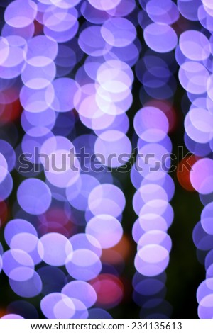 Defocused abstract violet and red light bokeh christmas background  - stock photo