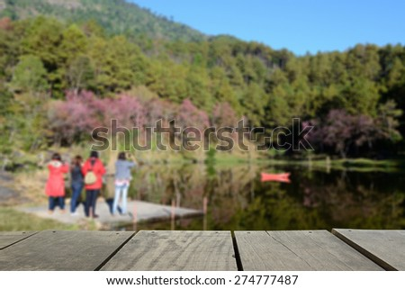 Defocused and blur image of terrace wood and Mountain and brook with 4 traveler for background usage - stock photo