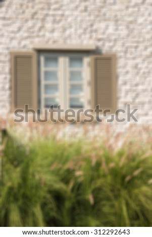 Defocused and blurred image for background of vintage house - stock photo